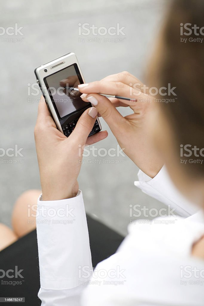 Woman using palmtop, close-up royalty-free stock photo