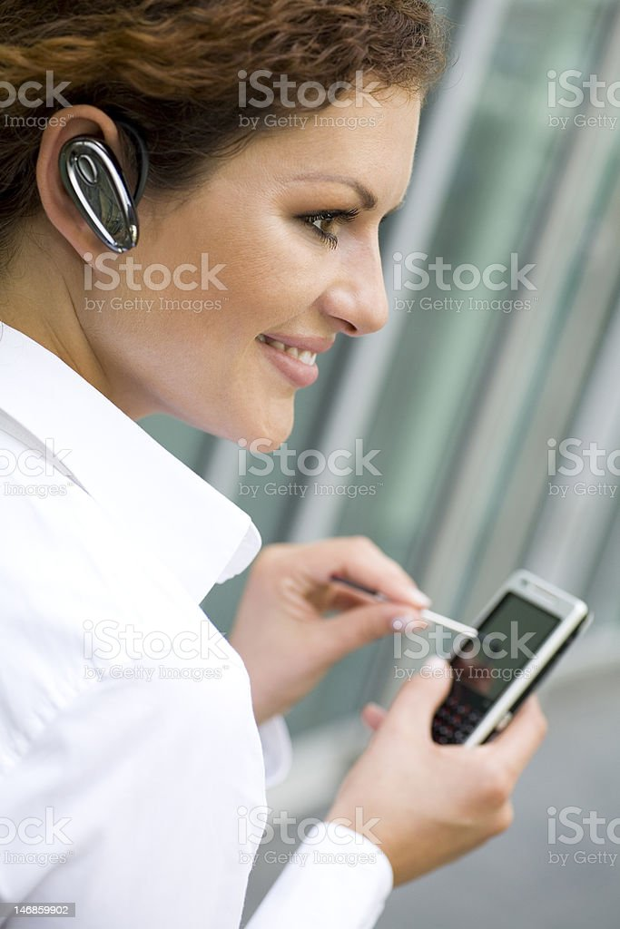Woman using palmtop royalty-free stock photo
