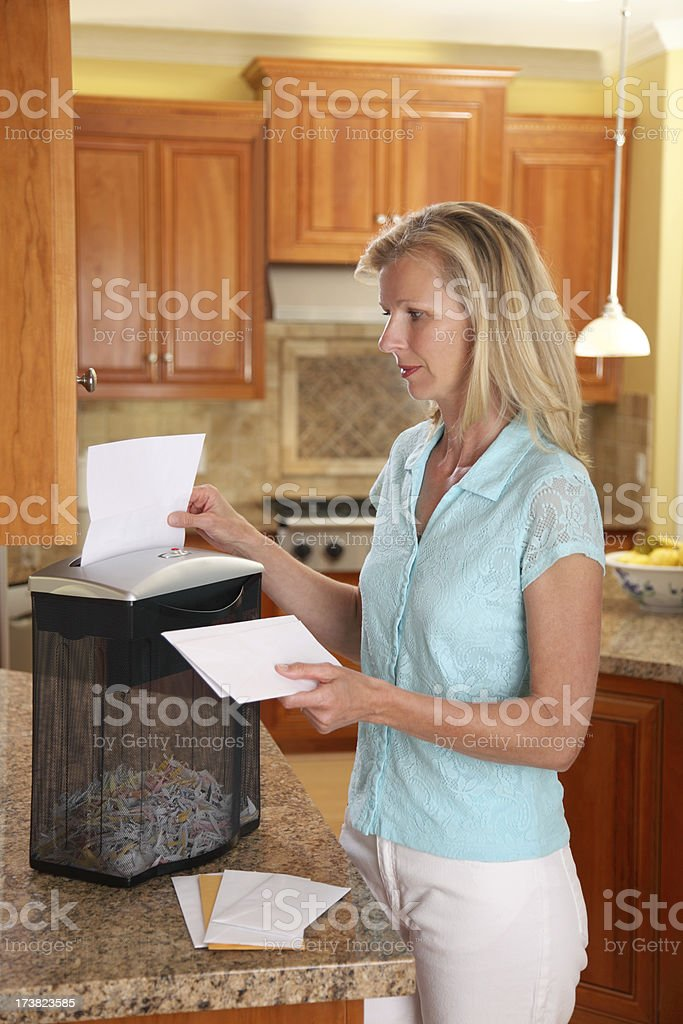 Woman Using Paper Shredder stock photo