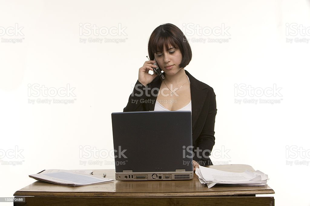 Woman using PC and cell phone royalty-free stock photo