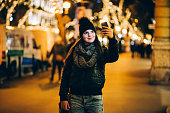 woman using phone in Budapest night