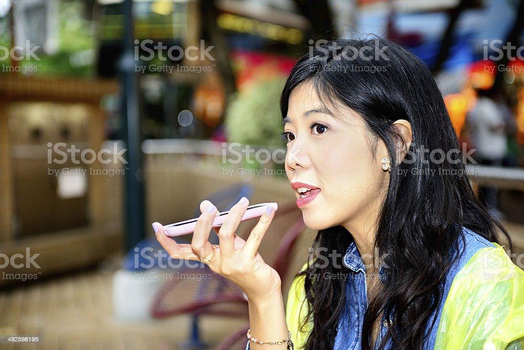 Woman using phone speaker stock photo