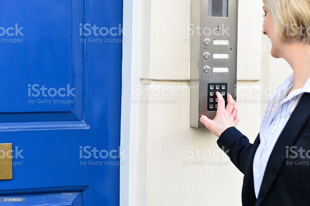 Woman using security system stock photo