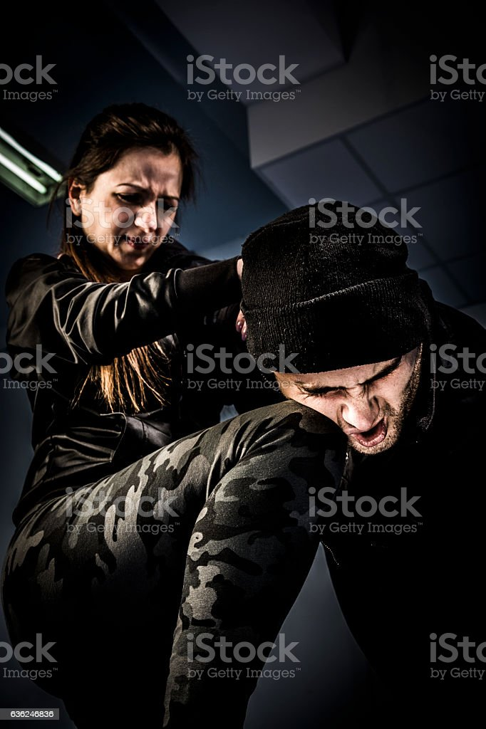 Woman using self defense technique against attacker stock photo