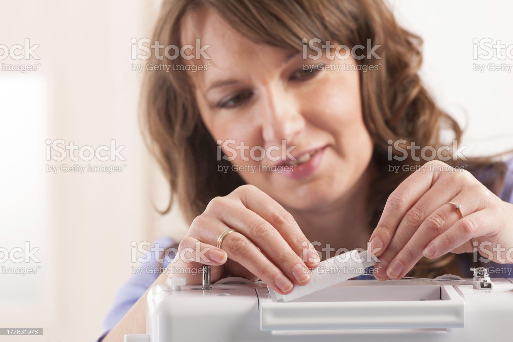 woman using sewing machine royalty-free stock photo