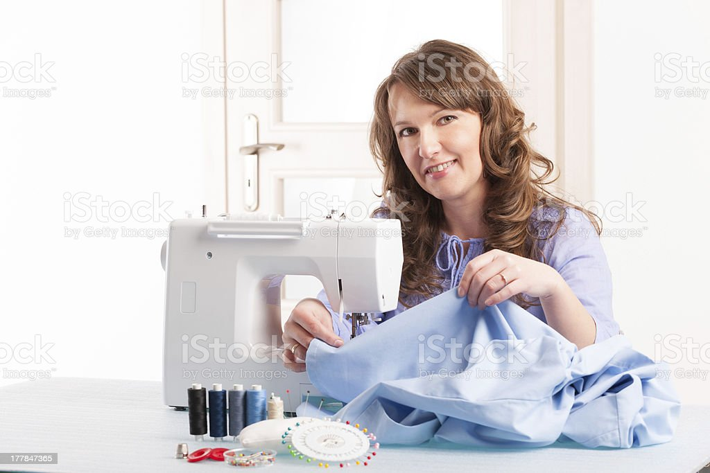 woman using sewing machine royalty-free stock photo