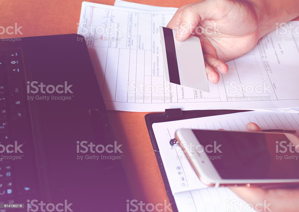 Woman using smart phone and pay by credit card stock photo