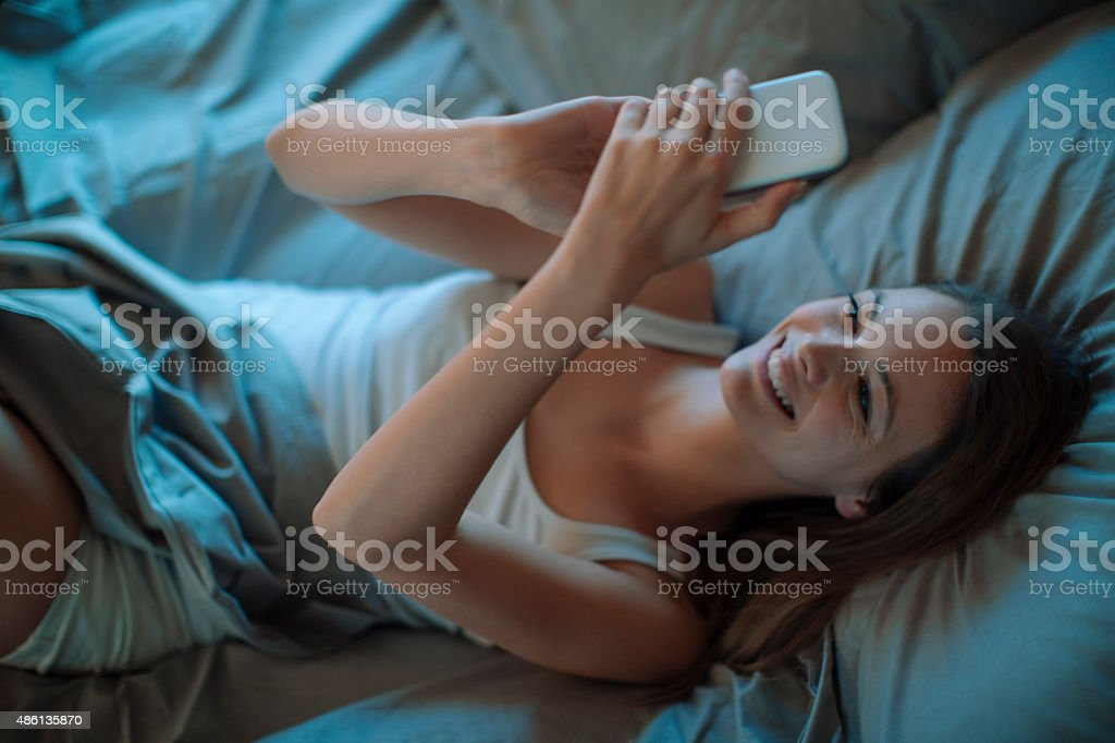 Woman using smart phone stock photo