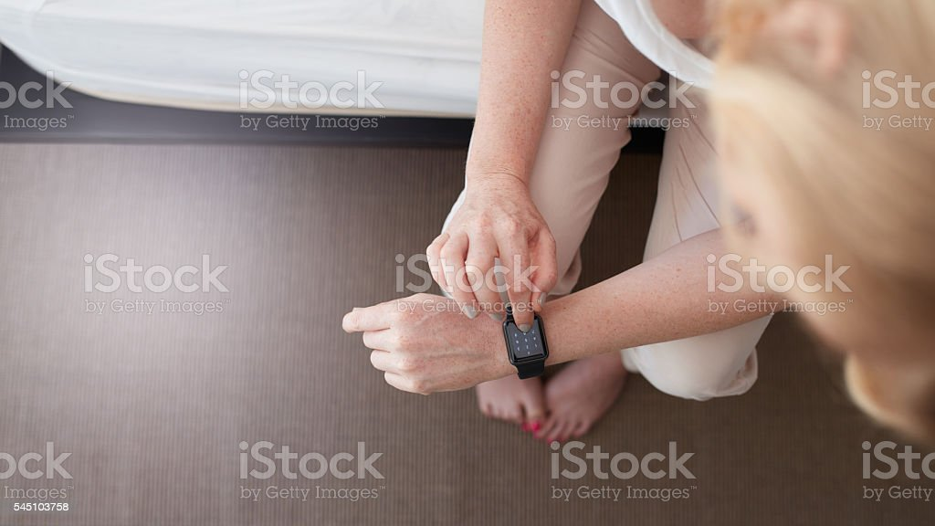 Woman using smart watch stock photo