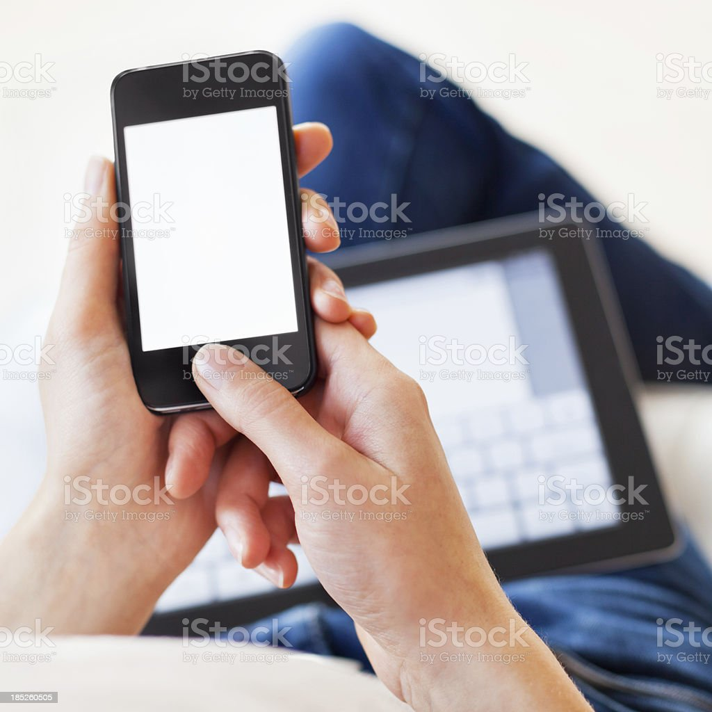 Woman Using Smartphone and Digital Tablet stock photo