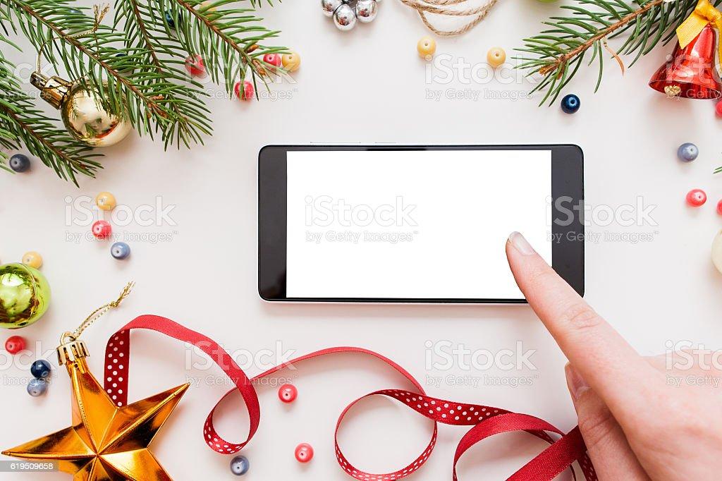 Woman using smartphone, Christmas discounts stock photo