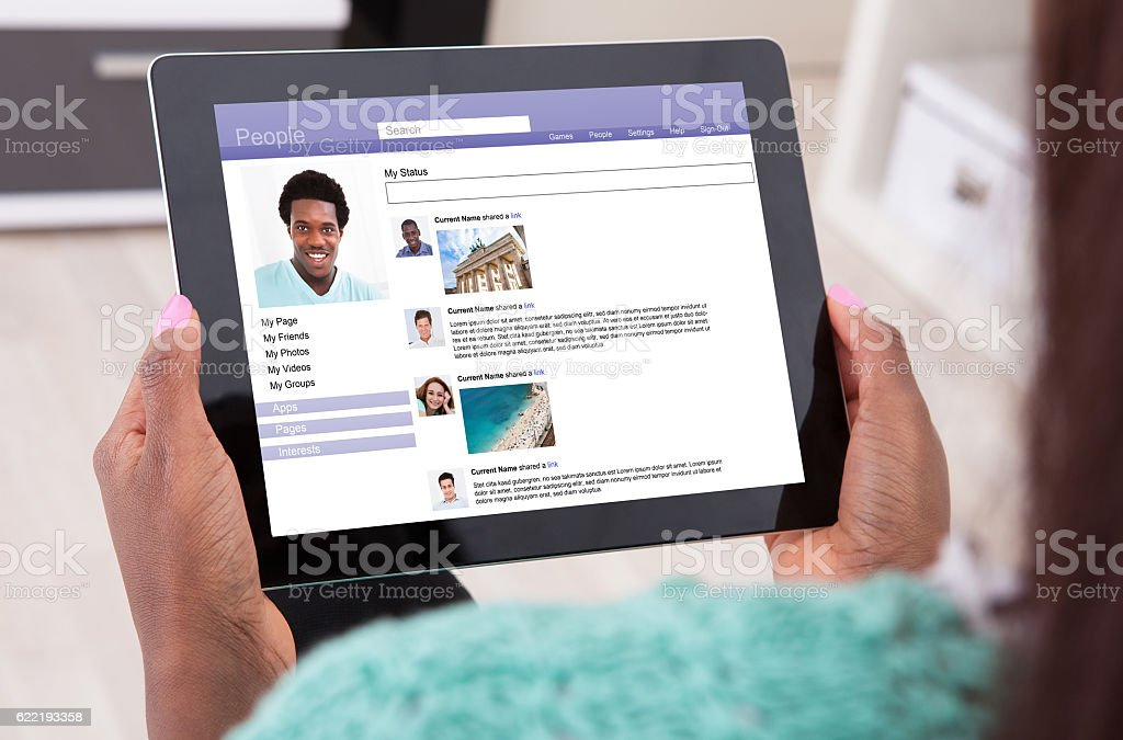 Woman Using Social Networking Site stock photo