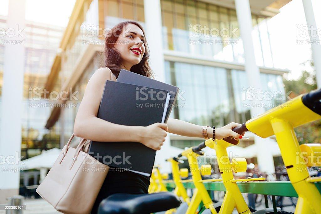 Woman using solar city bike stock photo