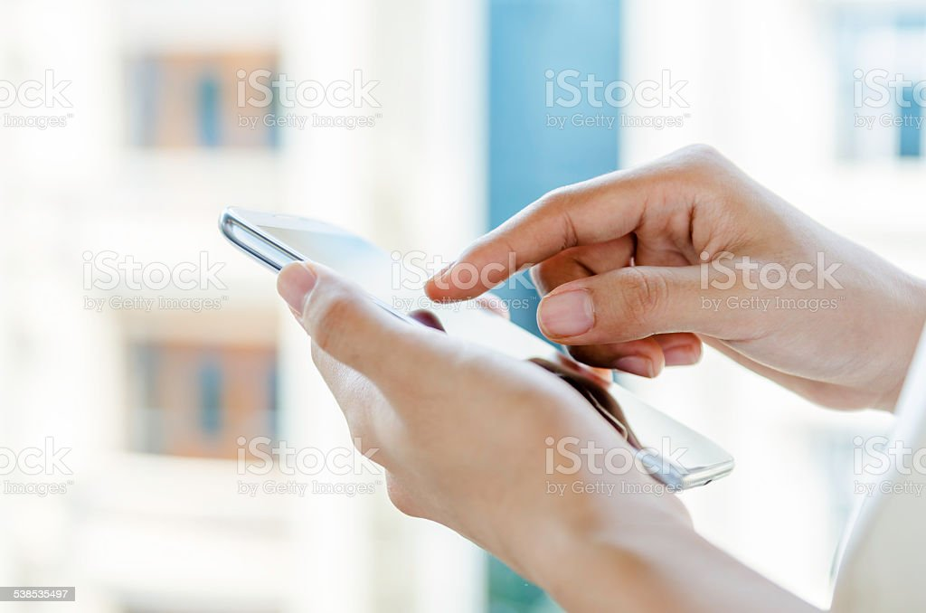 woman using tablet with stylus pen stock photo