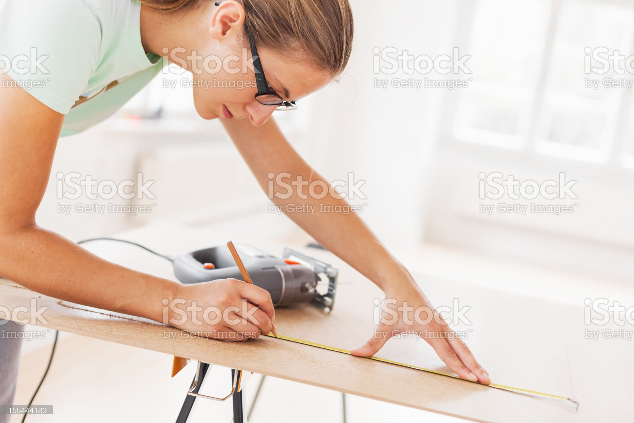 Woman Using Tape Measure royalty-free stock photo