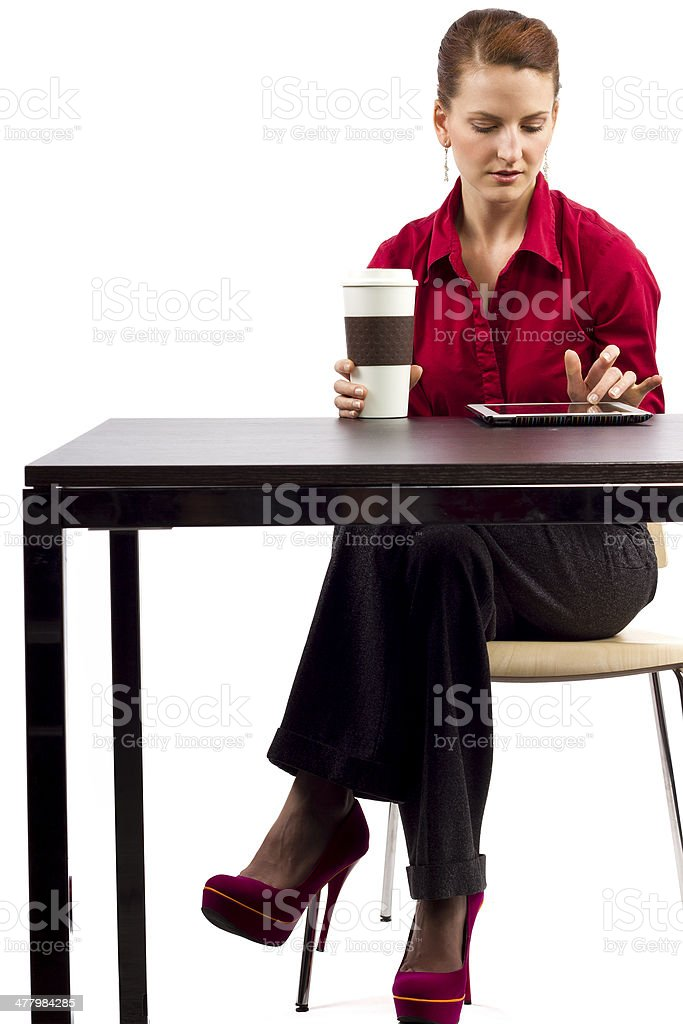 Woman Using the Internet on a Tablet in a Coffeeshop royalty-free stock photo