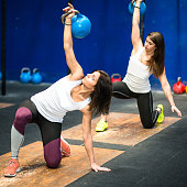 woman using the kettlebell on the gym