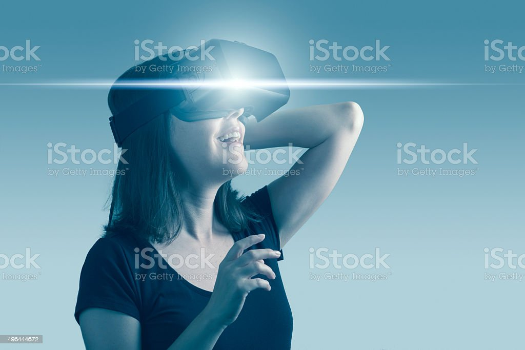 Woman Using Virtual Reality Headset stock photo