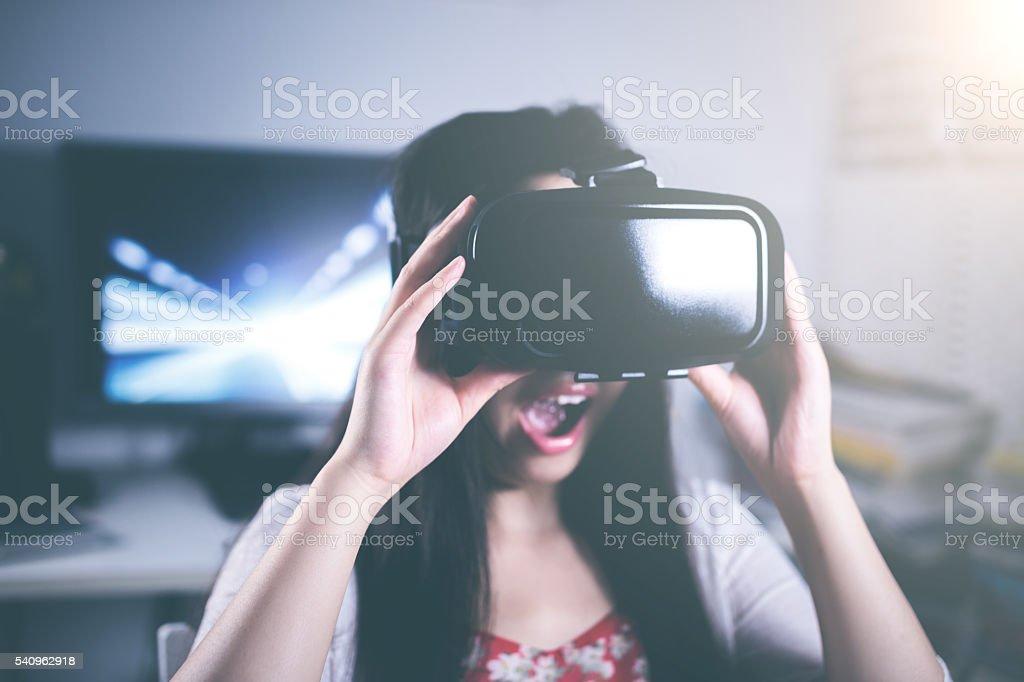 Woman using Virtual Reality headset stock photo