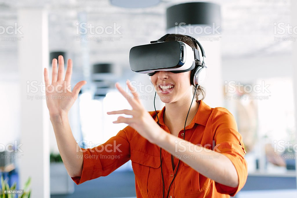 Woman using virtual reality simulator headset stock photo