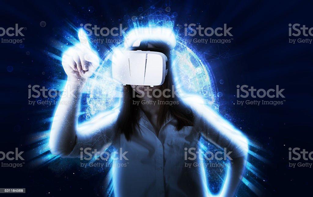 Woman Using VR Headset stock photo