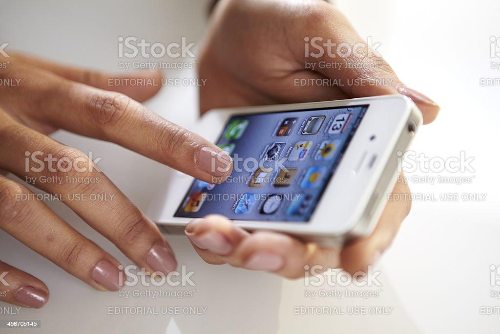 Woman using white iPhone 4S stock photo