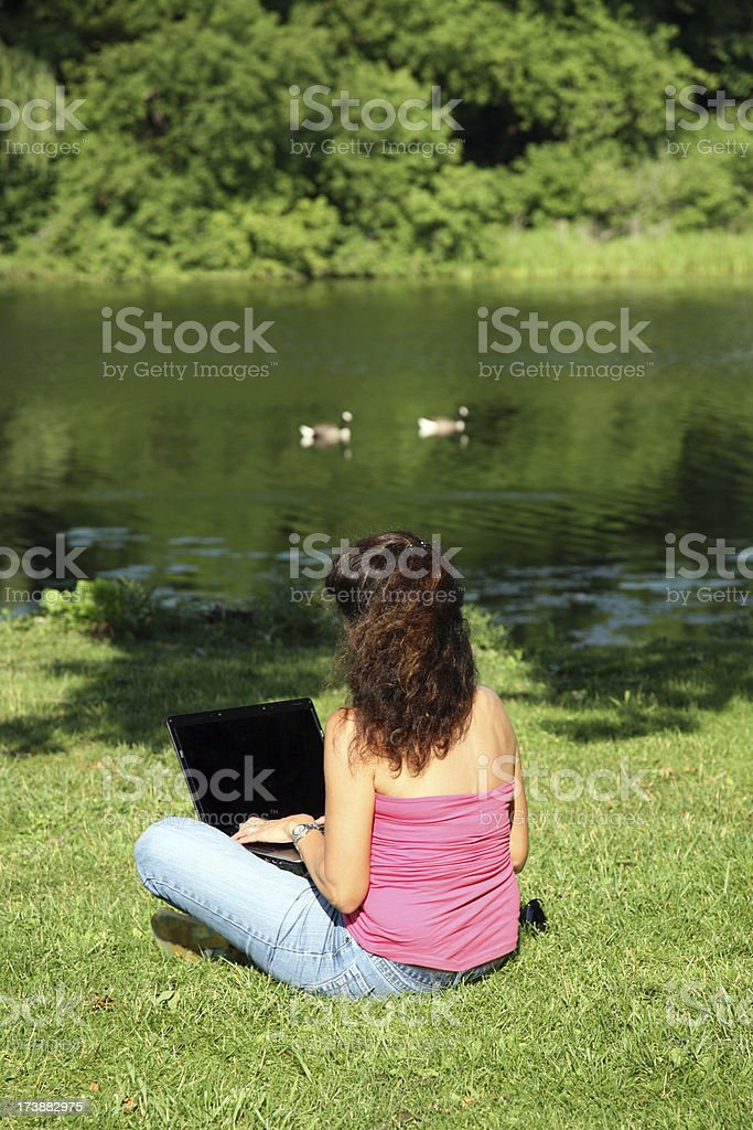 Woman using Wireless Internet Laptop Computer at Park royalty-free stock photo