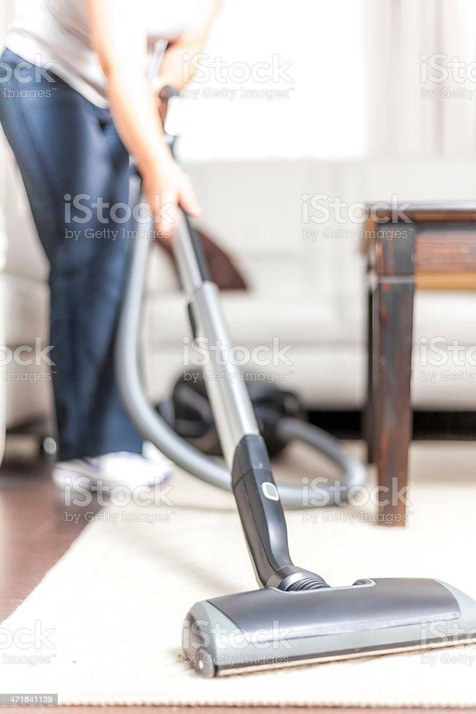 Woman Vacuuming stock photo