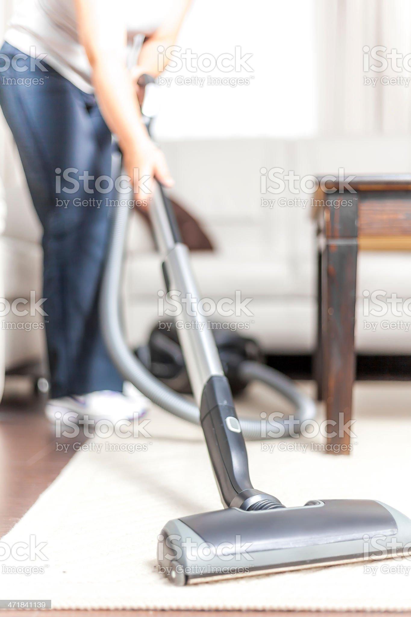Woman Vacuuming royalty-free stock photo