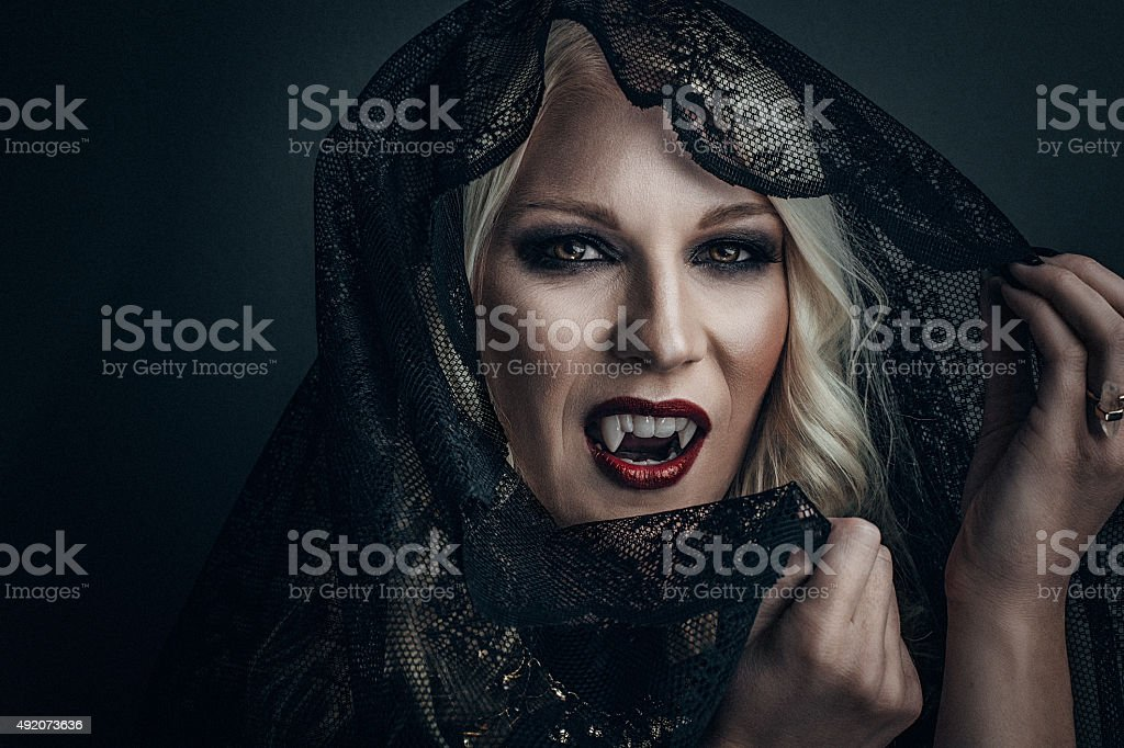 Woman vampire creative make up for halloween stock photo