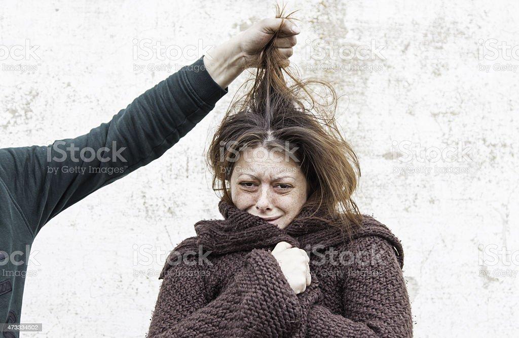 Woman victim of man stock photo