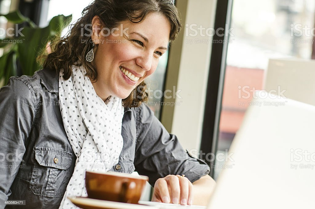 Woman video chatting in a coffee shop royalty-free stock photo
