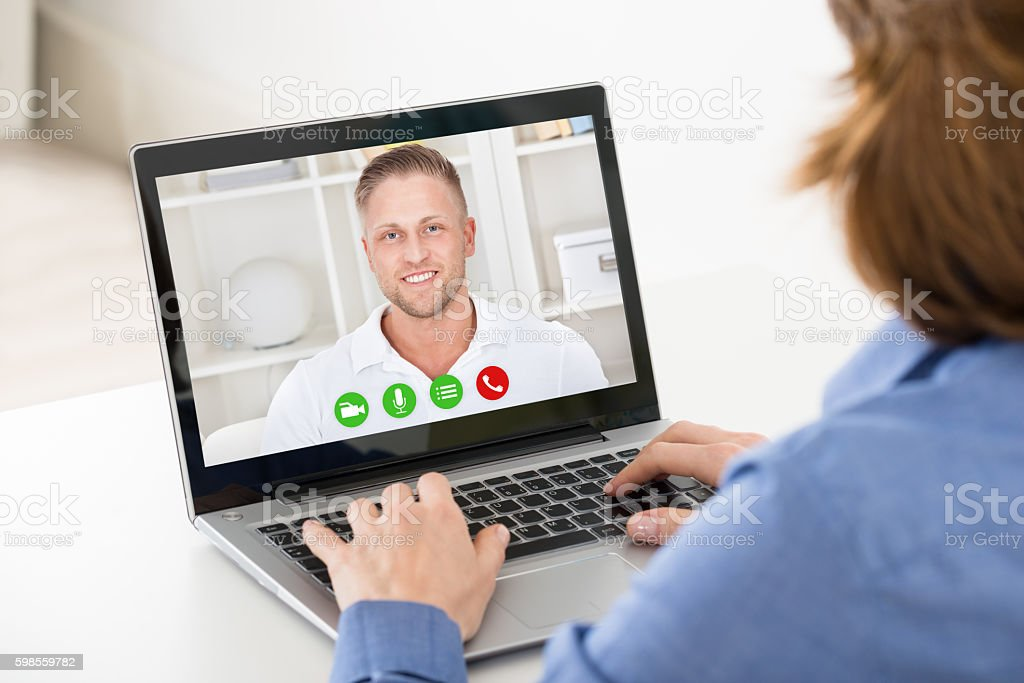 Woman Video Chatting On Laptop stock photo