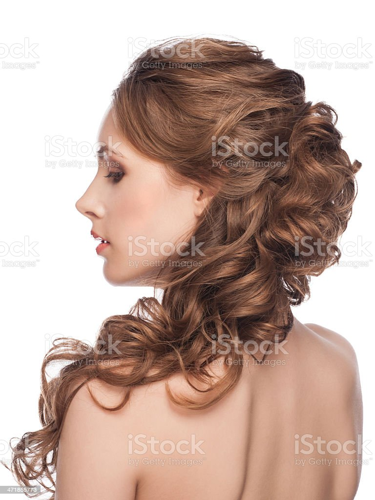 Woman viewed from behind with long hair over her shoulder stock photo