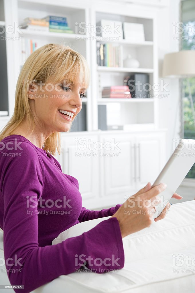 Woman viewing a digital tablet royalty-free stock photo