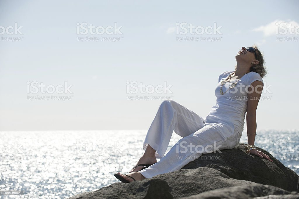 woman viewing sea in the sunshine royalty-free stock photo
