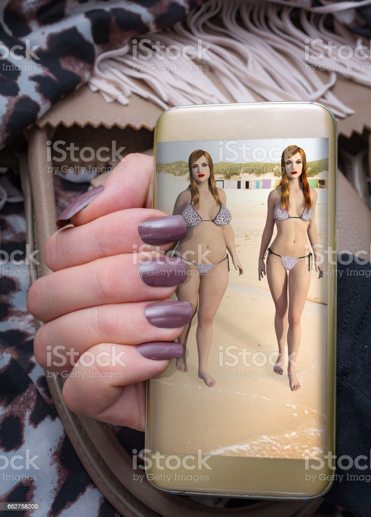 Woman viewing weight loss simulation on her smartphone stock photo