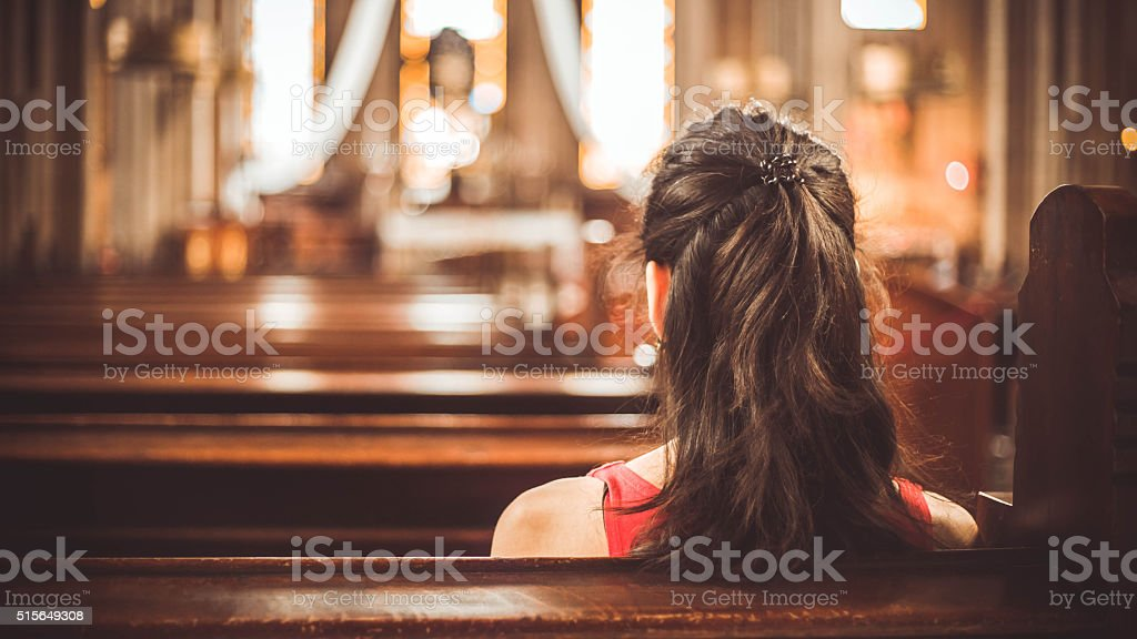 Woman visiting a christian church stock photo