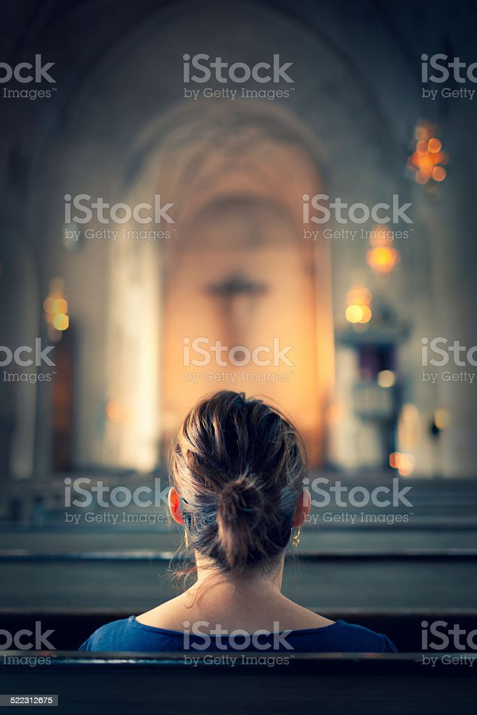 Woman visiting a christian church stock photo