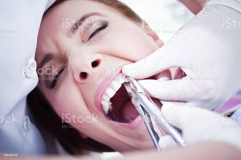 Woman visiting a dentist stock photo