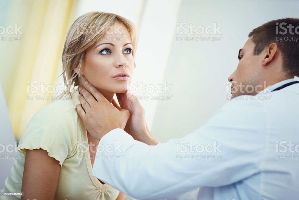 Woman visiting a doctor. stock photo