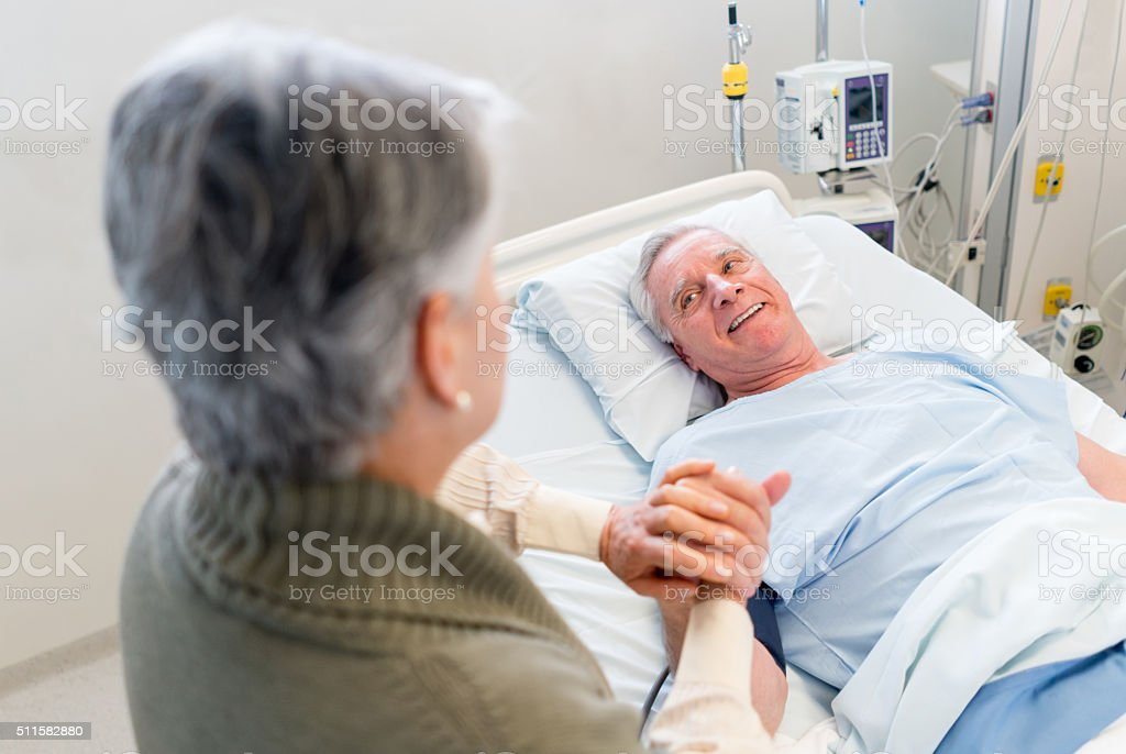 Woman visiting a patient at the ICU stock photo