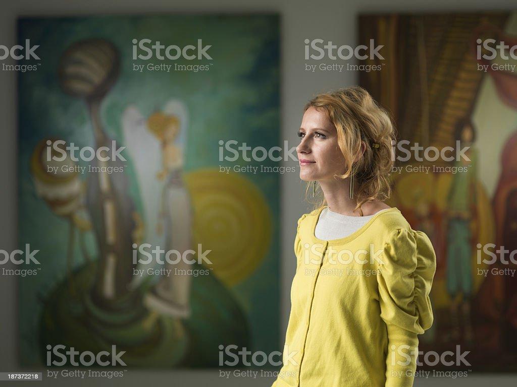woman visiting art gallery stock photo