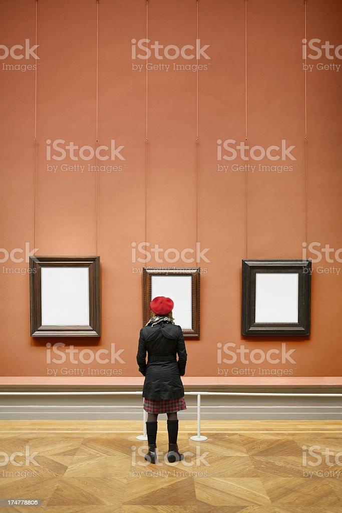 Woman visiting art museum stock photo