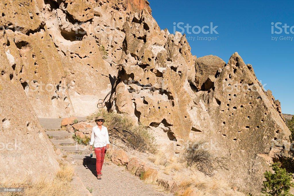 Woman visiting Bandelier National Monument near Santa Fe, New Mexico stock photo