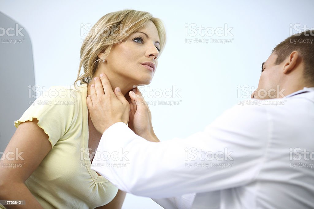 Woman visiting doctor. stock photo
