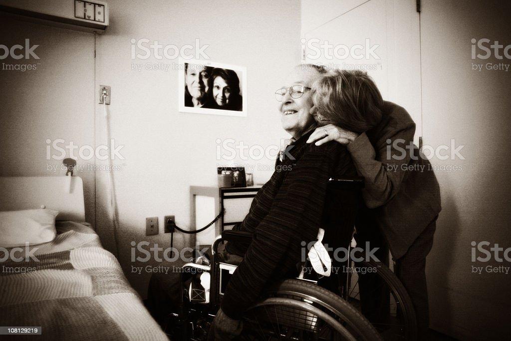 Woman Visiting Husband at Nursing Home royalty-free stock photo