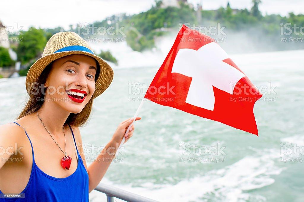 Woman visiting Rhine waterfall in Switzerland stock photo