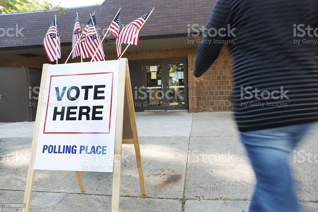 Woman Voter Entering USA Polling Place for American Government Election royalty-free stock photo
