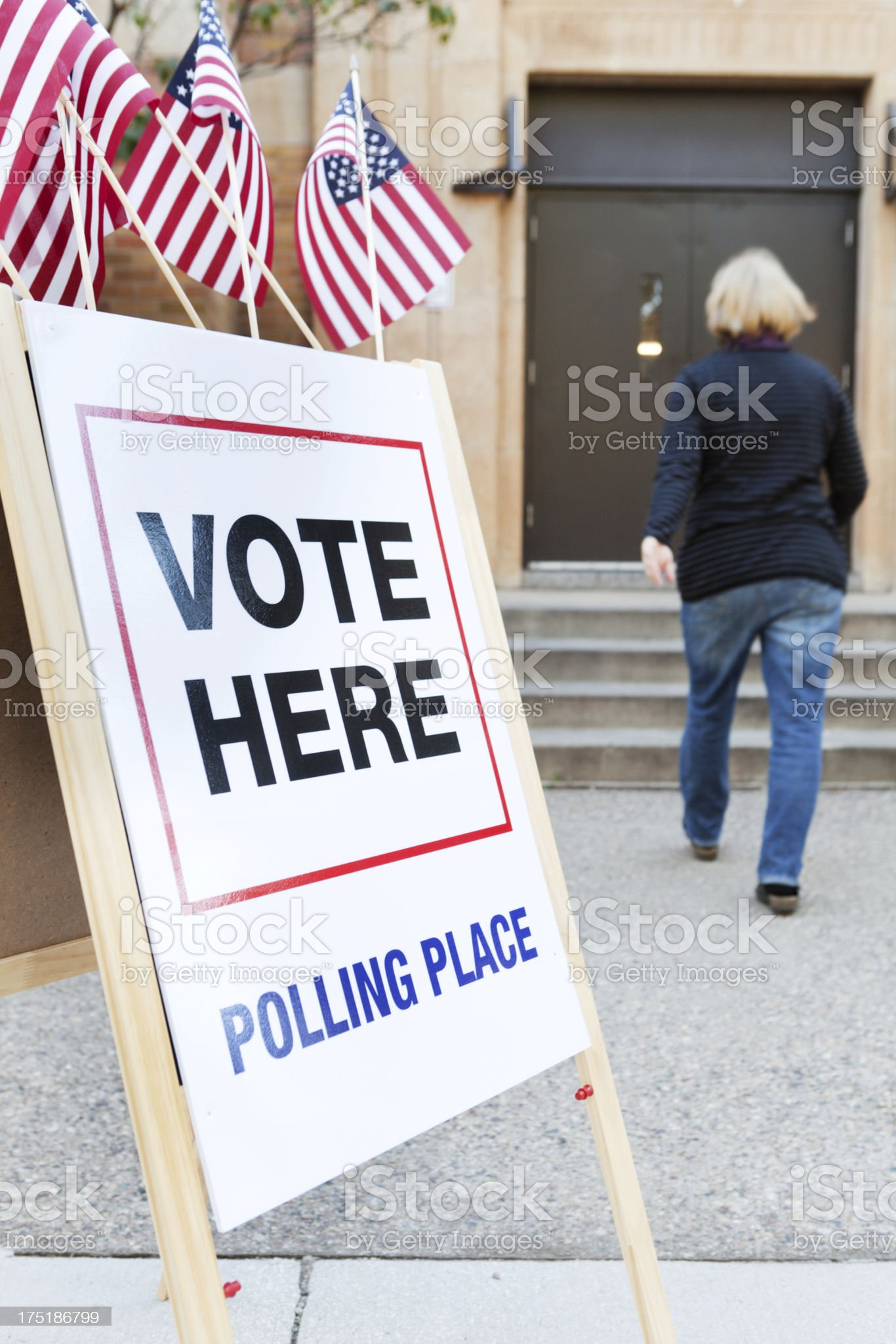 USA Woman Voter Entering Voting Polling Place for Government Election royalty-free stock photo